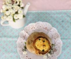 Bacalhau no pão com espinafres e azeitonas