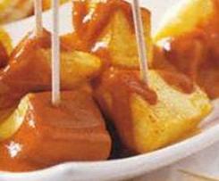Batatas douradas com molho picante